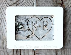 Hand carved birch bark with heart and initials