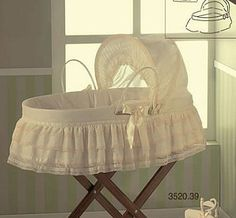 £302.00 Stunning moses basket in cream with lace decoration.  Comes with quilt, little pillow, sheet set and BS mattress. Stand also available as an extra. 85 x 45 x 25cm