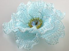 Just pictures of several beautiful beaded flowers...some should not be too difficult to figure out.
