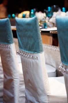 Chairs Are Covered With White And Blue Slipcovers Trimmed Gl Beads