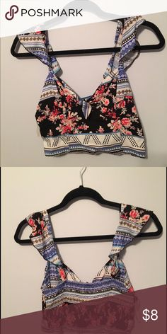 Flower crop top Cute crop top with with a tie in the front. Has flowy straps and over all is a tighter shirt. Multi colored with flowers on it. Mostly has blue, black, white, pink & red. Fire Los Angeles Tops Crop Tops