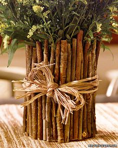 It's simple to make: Wrap a can with brown paper (or paint it to mask the surface), and cover it with small, straight sticks, gluing them in place (or securing them with a rubber band). Tied with a length of raffia, it makes a charming holder for garden flowers or a rustic desk organizer