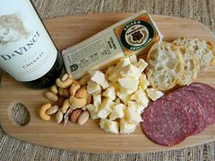 This pairing features our Extra-Aged Asiago, which goes nicely with some nuts, crusty artisan bread, sausage, and a glass of Chianti!