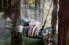 If I were Titania in 'A Midsummer Night's Dream', this is where I would sleep..a hanging bed in the forest complete with a nightlamp! Surreal...magical!