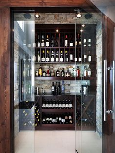 A small space is all you need to create a custom wine room.   Glass Doors, Stone Cellar, Wood Beams