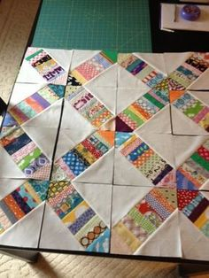 "Great scrap quilt idea - Missouri Star Quilt Company has called this pattern ""Crosswalk"" and has made a video too. Requires 1 Jelly Roll and 2 Charm Packs of white. Cute little pattern!"