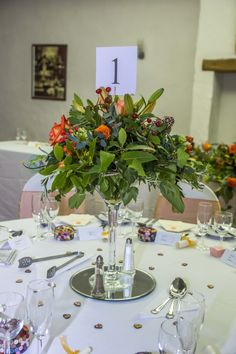 Flowers in a Martini glass as a centrepiece.