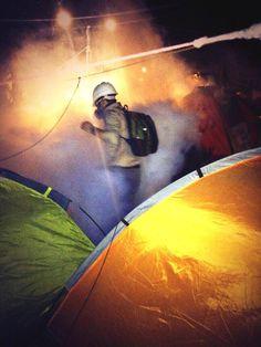 Police fire tear gas into Gezi Parkı.