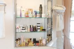 Aerin Lauder's top shelf ... ah, to be privileged. www.intothegloss.com