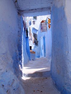 Around the Narrow Pathways by Machuca on flickr. Taken from an uncrowded pathway in Chefchaouen, Morocco. The whole city is painted indigo blue and white.