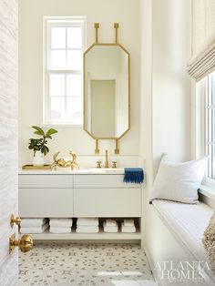 Glittery brass accents and a plush window seat create a sense of calm in this Melanie Turner-designed retreat. Bathroom Styling, Atlanta Homes, White Marble Bathrooms, Beach House Bathroom, Interior, Beach House Interior, Window Seat, Spanish Style Tile, Gray Painted Walls