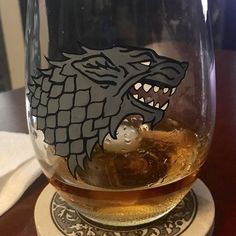 Well -- how do you relax after a long #Monday? #Whiskey in a tall glass and a single small ice cube.  #Seagrams7 #TheKingInTheNorth #HouseStark # Thanks to @harlequinn for the amazingly painted glass. Hit her up if you want one! (They're enamel painted so they handle being washed perfectly well)