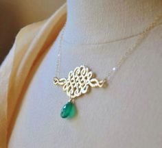 Beautiful 16K gold plated celtic knot pendant is adorned with a emerald green onyx gemstone and is suspended on a delicate 14K gold filled chain. A lovely necklace with a surprising pop of green color.  Dimension  pendant : 2 inch x 1.75 inch total necklace length: 17 inches + 2 inch extension  Thanks for looking.  For more unique jewelry, please visit my shop https://www.etsy.com/shop/YsmDesigns  Bridal party multiple order is always welcomed, please contact me for details on special bulk…