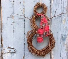 Handmade Grapevine snowman Christmas wreath with a recycled plaid scarf. Free shipping.