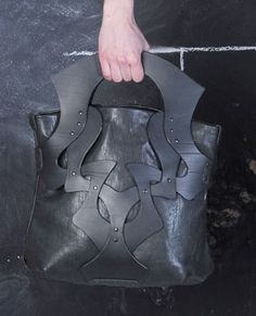 Leather Handbag by Anuk Harvey : Not very appealing but I like the handle and the cutout shapes in the bag. Quite unusual.