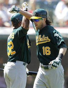 Josh Reddick, right, is greet by Yoenis Cespedes after hitting a two-run home run off Cleveland Indians' Justin Masterson durng the fifth inning of a baseball game, Thursday, Aug. 30, 2012