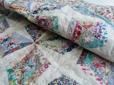 This baby/crib/cot quilt is made from the very best materials - Liberty of London tana lawn, calico and soft cotton and bamboo batting create a quilt