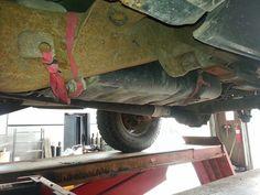 Ratchet strap holding up a gas tank.