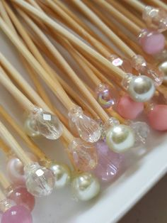 This is a set of 100 3.75 pink, crystal, and pearl skewers. Use these great sticks for fruit or dessert kabobs, as well as cold meat and cheese skewers. Great for weddings, birthday parties, and showers. These are made to order, so the skewers you will receive are an assortment of these and coordinating colors. Exact matches of beads shown in the picture cannot be guaranteed, as suppliers stock changes. If a specific bead or shape is wanted, please contact me to see if it is available. Also…