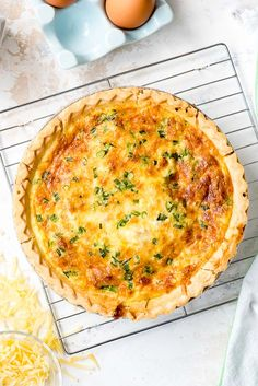 Golden brown Quiche Lorraine on a cooking rack
