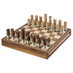 Chess Set (Western) - Royal Selangor's western chess set simplifies the elaborate design of the Staunton model. The chess pieces take their inspiration from the elegant minimalist chess sets designed by modern artists of the 1920s. Made from satin finish pewter, walnut and maple wood, the smooth geometric chess pieces retain the simplicity and legibility of the Staunton.