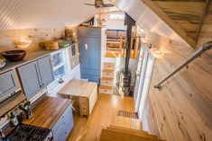 Built by Mitchcraft Tiny Homes for their client, Tara, this 33-foot gooseneck tiny house offers a modern style with farmhouse style accents. The living room sits over the gooseneck, providing enough headroom to stand.