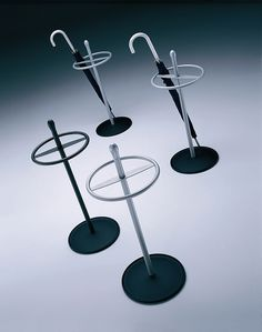 Reception_Umbrella stand Rama:  Umbrella stands-Hallway-Rama-Vilagrasa Matching umbrella stand finished with a piece of turned steel. Finishes: plastic in blue, vanilla or anthracite with aluminium RAL 9006 coloured tube, or anthracite coloured plastic with anthracite coloured tube or satin finished stainless steel tube. Umbrella holding ring in anthracite or aluminium RAL 9006 colored tube.   Ø 308 x 750 mm.