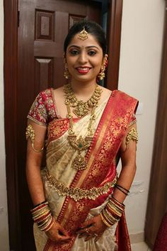 Elegant Gold Temple Jewelry and Traditional Ivory, Red and Gold Kanjivaram Silk Saree on a South Indian Bride Indian Bridal Hairstyles, Indian Bridal Wear, Indian Wear, Indian Dresses, Indian Outfits, Saree Wedding, Bridal Sarees, Tamil Wedding, Wedding Bride
