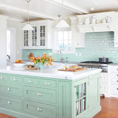 Ideas for our kitchen splash back. Surf light green glass subway tile backsplash. LOVE THIS KITCHEN