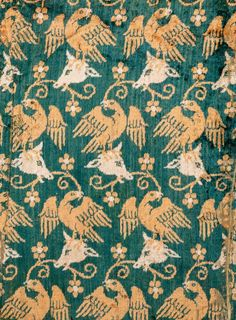 Velvet showing eagles and cows' heads; one of the earliest known examples of a velvet with a figurative design. Italy, last quarter 14th century, silk. Abegg-Stiftung