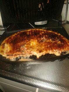 Halve pizza over, tosti ijzer ziet er niet mooi uit maar is wel veel lekkerder dan magnetron of opnieuw in de oven