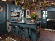 Primitive kitchen. Particularly enjoy the drying herbs hanging from the ceiling :)