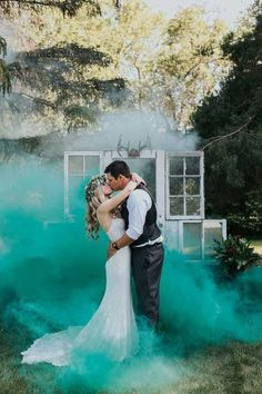 Teal Smoke Bomb Wedding Photo
