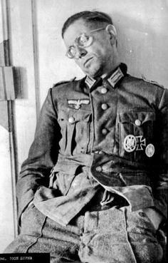 An officer of the Wehrmacht, asleep after questioning by the NKVD.  A rare photograph of the Second World War, of Russian photographer. A German officer, who was captured by russian scouts of the 49th Guards Rifle Division.     Author: Anatoliy Lambros