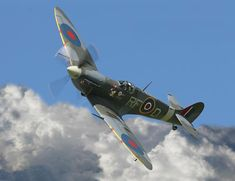 Spitfire above the clouds
