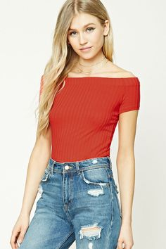 A ribbed knit top featuring an elasticized off-the-shoulder neckline and short sleeves.