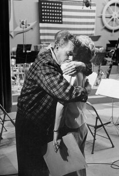 "A tender moment, Desi embraces Lucille after taping a scene. | 21 Wonderful Behind-The-Scenes Photos Of ""I Love Lucy"""