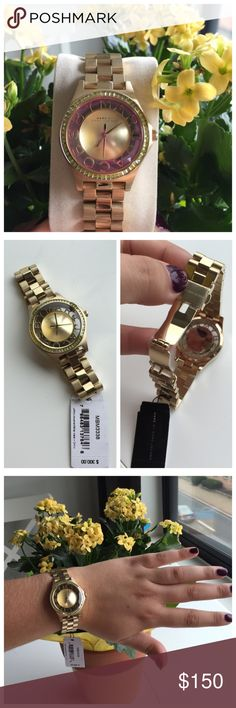🎃Marc Jacobs Henry Champagne Transparent Dial Gold tone case and bracelet. Transparent dial surrounded by champagne (almost light green) rhinestones. Water resistant at 50 meters. Brand new with tags and plastic protective pieces. Worn only for model picture. Functioning battery. All original links are in bracelet and can be taken out for sizing. Comes with fossil tin, not Marc Jacobs box. Marc by Marc Jacobs Accessories Watches