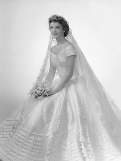 In honor of Presidents' Day, we are honoring the best First Lady wedding dress ever in existence. In 1953, Ann Cole Lowe designed Jacqueline Kennedy Onassis' wedding dress for her marriage to John F. Kennedy. The voluminous, off-the-shoulder dress was constructed out of 50 yards of ivory silk taffeta.