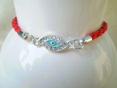 Red faux leather bracelet with rhinestone evil eye by MyleneV, $10.00