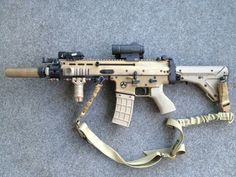 Scar-L with some Magpul furniture, but oddly not a Magpul magazine. I'm really digging that stock on the Scar.