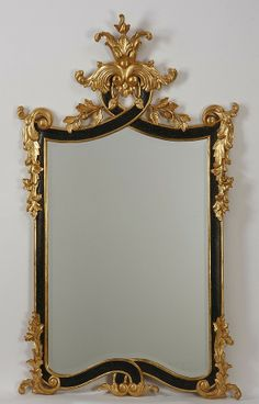 Rococo inspired carved and parcel gilt beveled glass mirror, crafted by Harrison Gil, USA