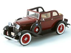 This Ford V8 (1932) Diecast Model Car from Bonnie and Clyde is Black and Red and features working wheels, steering and also opening bonnet with engine, boot, doors. It is made by Franklin Mint and is 1:24 scale.    Hand-assembled from over 100 parts, this gorgeously detailed model comes with open and closed roof attachments, Bonnie and Clyde reference material and the following miniature accessories:  - Gun chest containing shotguns and revolvers - Ammo boxes and shells - Money bags - Fedora… Ammo Boxes, Ford V8, Money Bags, Miniature Cars, Model Shop, Bonnie N Clyde, Franklin Mint, Car Makes, Shotguns