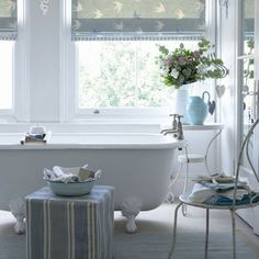 The palest blues - beautiful. Like the enamel bowl of bath essentials on the striped stool - perfect for the guest bath.
