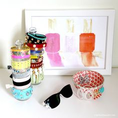 3 DIY Organizing Solutions for Your Home :: Hometalk.  Use bottles or skinny vases to organize your bracelets.  #organize #jewelry