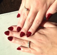 Red blood almond stiletto shaped nails