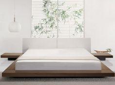 Zoom d'un grand lit en bois