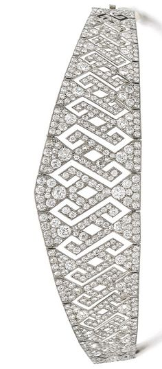 DIAMOND DIADEM, EARLY 20TH CENTURY, The articulated and graduated band of open work geometric design, set with cushion-shaped, circular- and single-cut diamonds, diadem detachable from frame and may be worn as a bracelet, bracelet length approximately 163mm, one diamond deficient, accompanied by screw driver, fitted case stamped A. Aucoc.