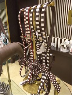 This entire environment was visually interesting, though my fixture focus was to capture this Henri Bendel Belt T-Stand Outfitting. Spirit Store, Henri Bendel, Industrial Chic, Visual Merchandising, Craft Fairs, Brass, Environment, Metallic, Retail