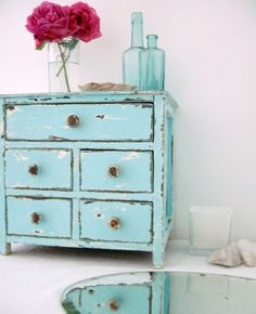 this looks similar to my current nightstands (the shape), so i'm thinking i could paint them, distress them, and change out the knobs to look like this!